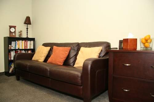 marriage therapy couch brown leather with three pillows